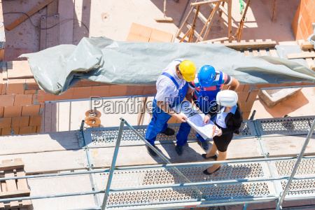 team discusses construction plans at a
