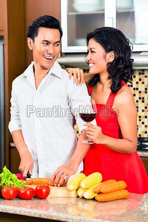 asian couple preparing food in domestic