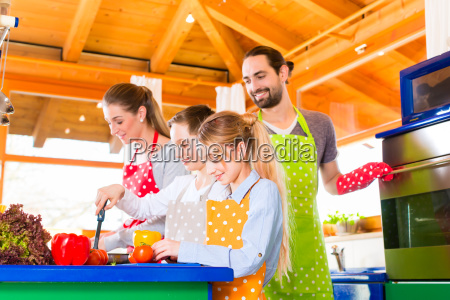 family cooking in kitchen healthy eating