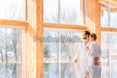 couple enjoying view in wellness spa