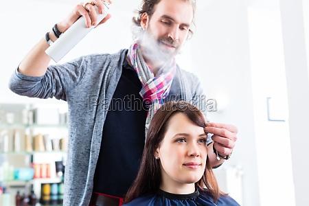 hairdresser coiffed womans hair in salon