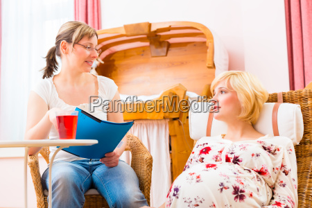 midwife with mother at pregnancy counselling