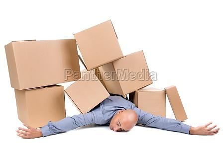 businessman under boxes