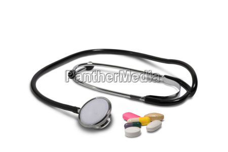 stethoscope and tablets capsules