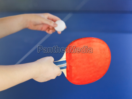 girl plays in table tennis with