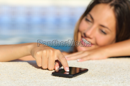 happy woman in vacations texting in