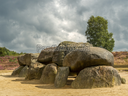 dramatic sky over megalithic stones in
