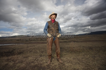a cowboy on a ranch in