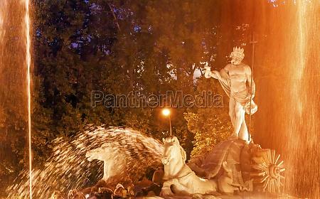 neptune chariot horses statue fountain night