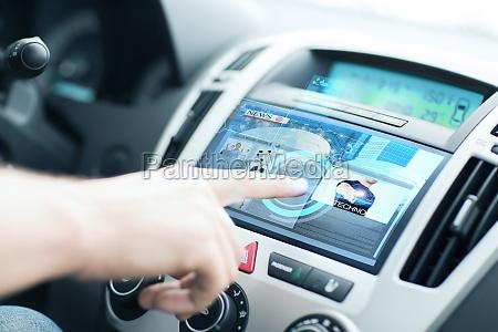 man using car control panel to