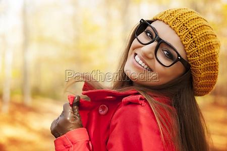 fashionable young woman enjoying in autumn