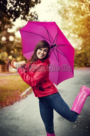 happy woman with pink umbrella and