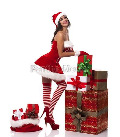 smiling santa woman with many christmas