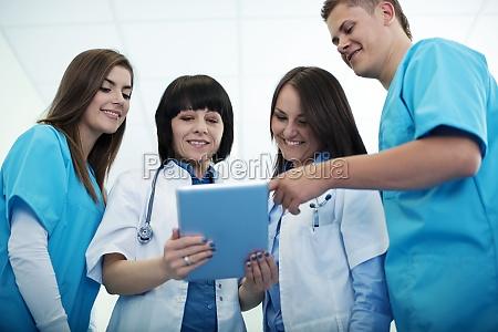 medical, team, checking, results, on, digital - 12115304