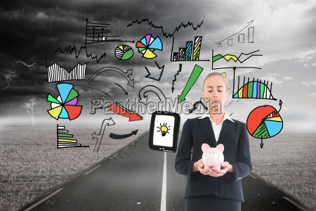 composite image of businesswoman holding pink