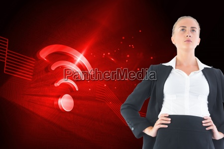composite image of businesswoman standing with