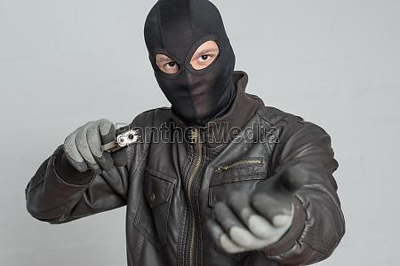 burglar threatening with weapon