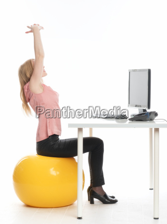 businesswoman on a ball seat