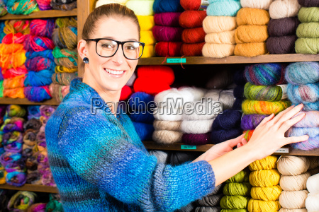 young woman in dry goods store
