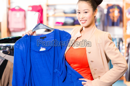woman while shopping in the store