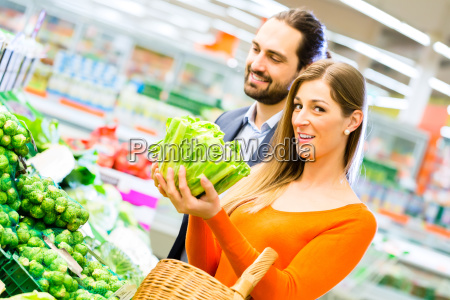 woman chooses vegetables in the food