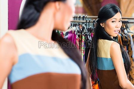 asian woman shopping in fashion store