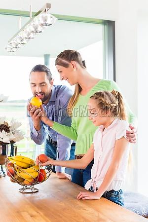 family eating fresh fruit for healthy