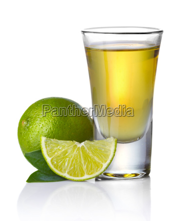 gold tequila shot with lime isolated