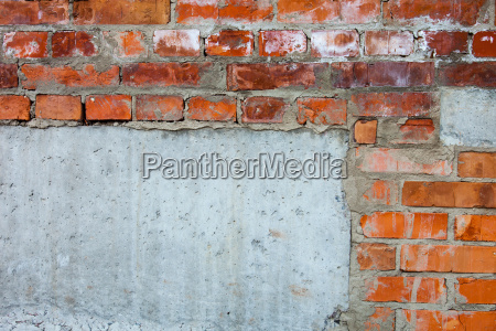 brick wall with parts of concrete