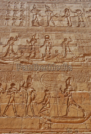 reliefs of egyptian hieroglyphs on wall
