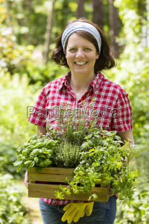 young woman with herbs in the
