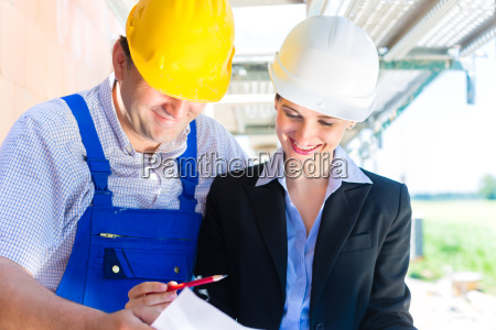 team inspects construction plans on a