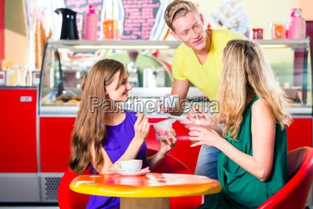 friends meet in eiscafe