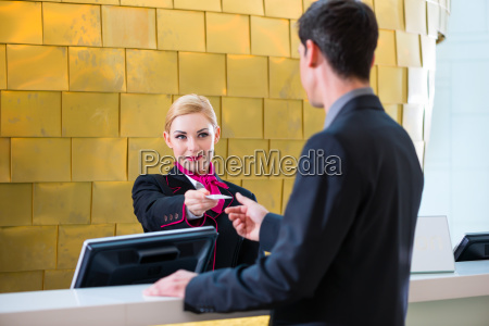 receptionist check in at the hotel