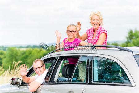 family travels by car in the