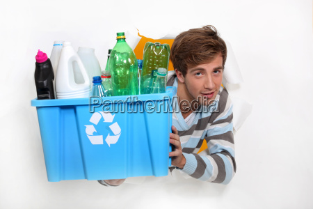 man holding crate of bottles to