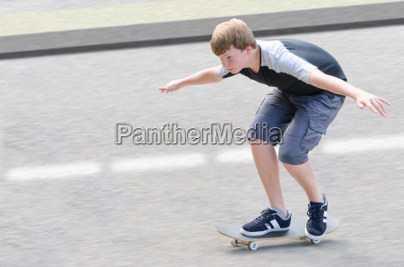 young skater teenager guy in motion