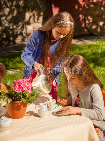 little girls playing in teatime at
