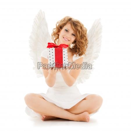 happy teenage angel girl with christmas