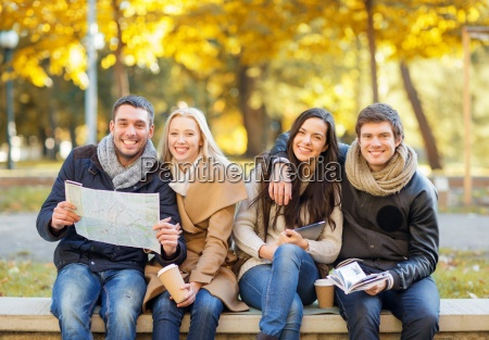 couples with tourist map in autumn