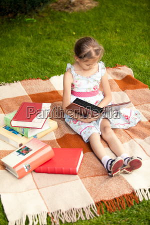 girl with photo album sitting on