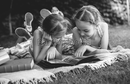 monochrome photo of young girls looking