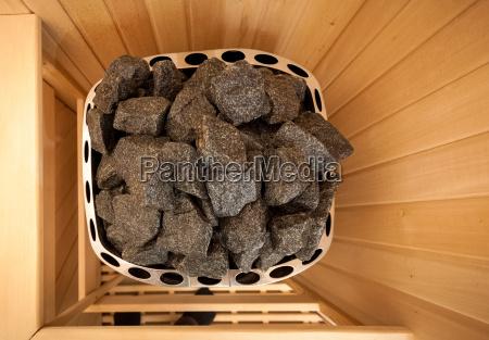 shot of stones in sauna oven