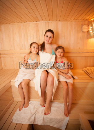 woman with little girls relaxing at