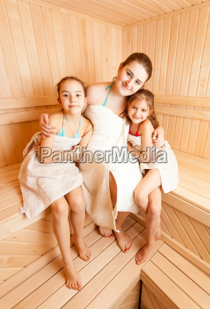 mother with two daughters relaxing at