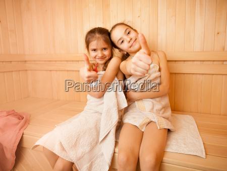 happy little girls in sauna showing