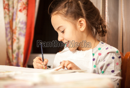 diligent girl doing drawings with brush