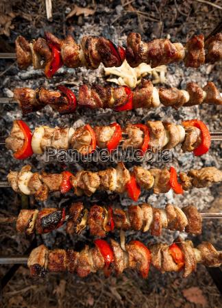 photo of kebab being roasted on