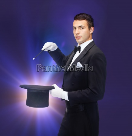 magician in top hat with magic