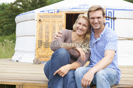 couple enjoying camping holiday in traditional